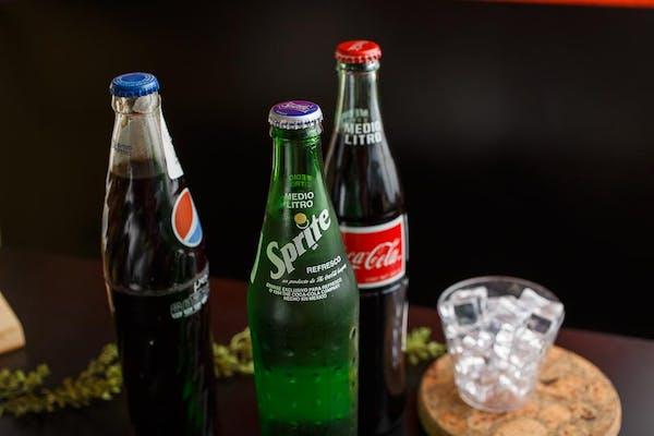 Plastic Bottle  or Sm. Glass bottle drink