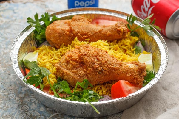 Fried Chicken over Yellow Rice