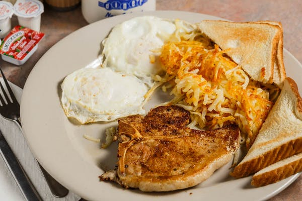 B7. Pork Chop, (2) Eggs, Hashbrowns & Toast