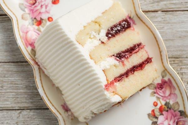 Gourmet Raspberry-Filled Vanilla Cake Slice