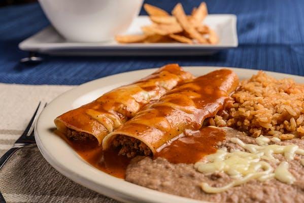 28. (2) Enchiladas, Rice & Beans