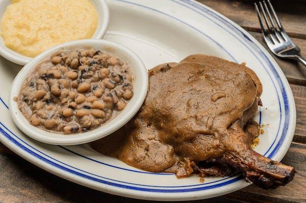 CJ's Smothered Pork Chop