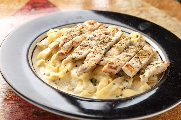 Fettuccine Alfredo with Grilled Chicken Breast.