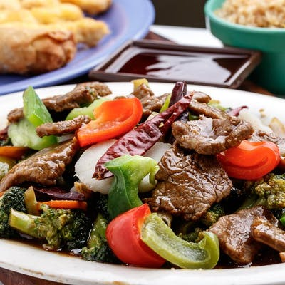 C6. Hunan Beef with Sweet & Sour Chicken